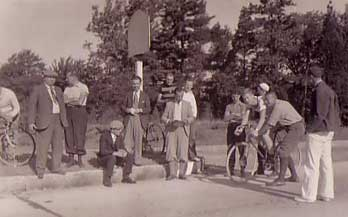 [vintage photo of a time trial start]